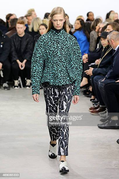 A model walks the runway at the Proenza Schouler fashion show during MercedesBenz Fashion Week Fall 2014 on February 12 2014 in New York City