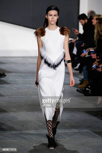 A model walks the runway at the Proenza Schouler show during MercedesBenz Fashion Week Fall 2015 at the Marcel Breuer Building on February 18 2015 in...