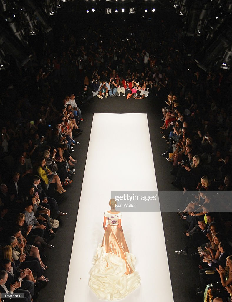 A model walks the runway at the Project Runway Spring 2014 fashion show during Mercedes-Benz Fashion Week Spring 2014 on September 6, 2013 in New York City.