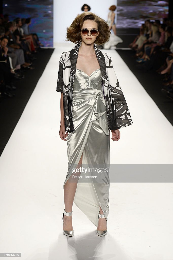A model walks the runway at the Project Runway Spring 2014 fashion show during Mercedes-Benz Fashion Week at Lincoln Center on September 6, 2013 in New York City.