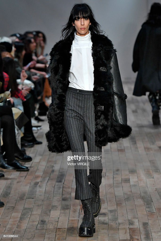 model-walks-the-runway-at-the-r13-fashion-show-during-new-york-week-picture-id641339544
