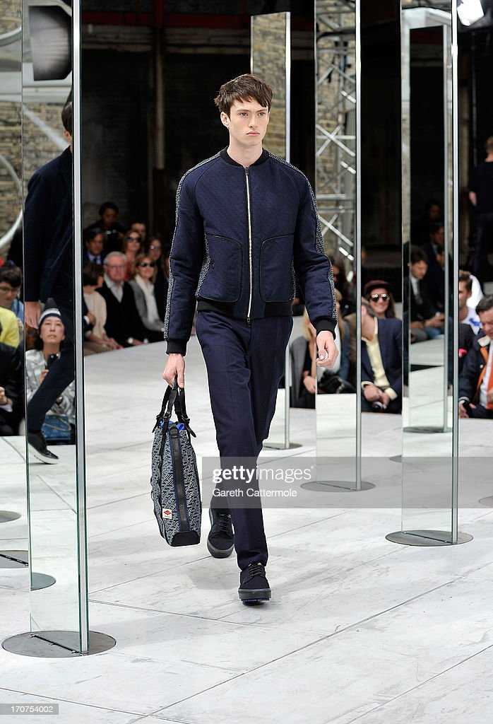 A model walks the runway at the rag bone show during the London Collections MEN SS14 at Farmiloe Building on June 17 2013 in London England