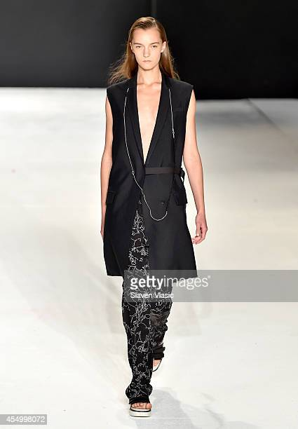 A model walks the runway at the rag bone Spring 2015 Women's Collection fashion show during MercedesBenz Fashion Week Spring 2015 at Skylight at...