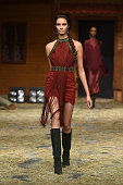 A model walks the runway at the Raisa Vanessa Sason show during Mercedes Benz Fashion Week Istanbul SS15 on October 13 2014 in Istanbul Turkey