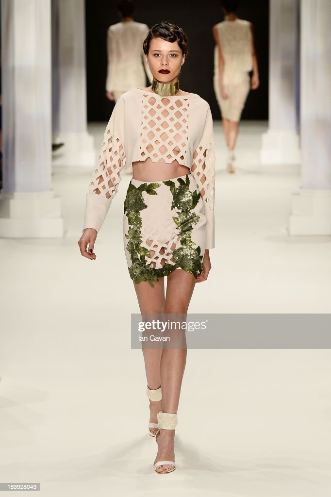 A model walks the runway at the Raisa-Vanessa Sason show during Mercedes-Benz Fashion Week Istanbul s/s 2014 Presented By American Express on October 10, 2013 in Istanbul, Turkey.