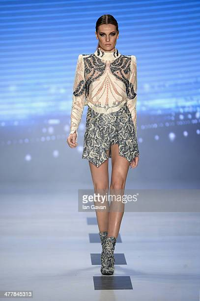 A model walks the runway at the RaisaVanessa Sason show during MBFWI presented by American Express Fall/Winter 2014 on March 11 2014 in Istanbul...