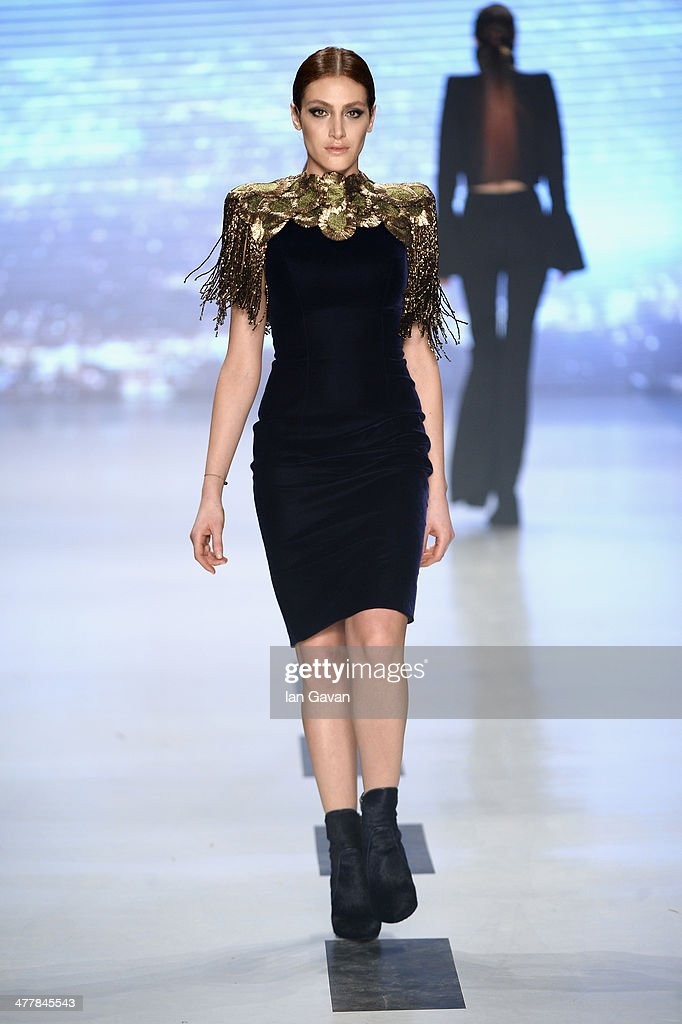 A model walks the runway at the Raisa-Vanessa Sason show during MBFWI presented by American Express Fall/Winter 2014 on March 11, 2014 in Istanbul, Turkey.