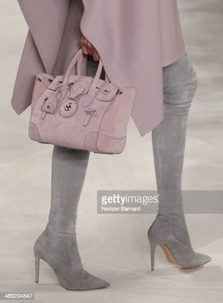 A model walks the runway at the Ralph Lauren fashion show during MercedesBenz Fashion Week Fall 2014 at St John Center Studios on February 13 2014 in...