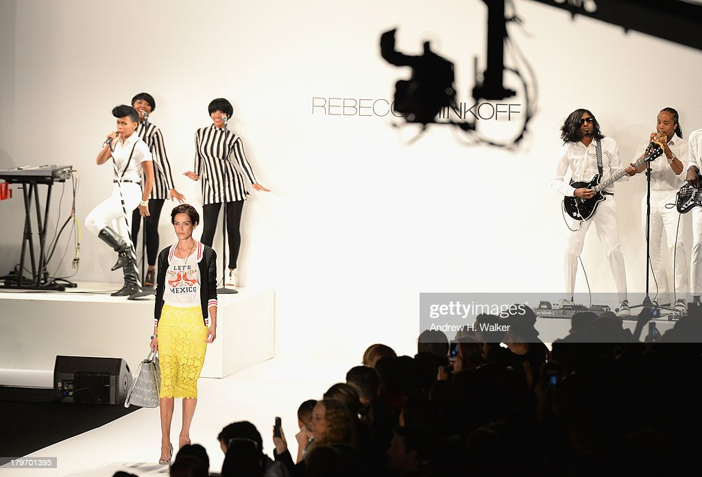 A model walks the runway at the Rebecca Minkoff Spring 2014 runway show while musician Janelle Monae performs during Mercedes-Benz Fashion Week Spring 2014 at Lincoln Center for the Performing Arts on September 6, 2013 in New York City.
