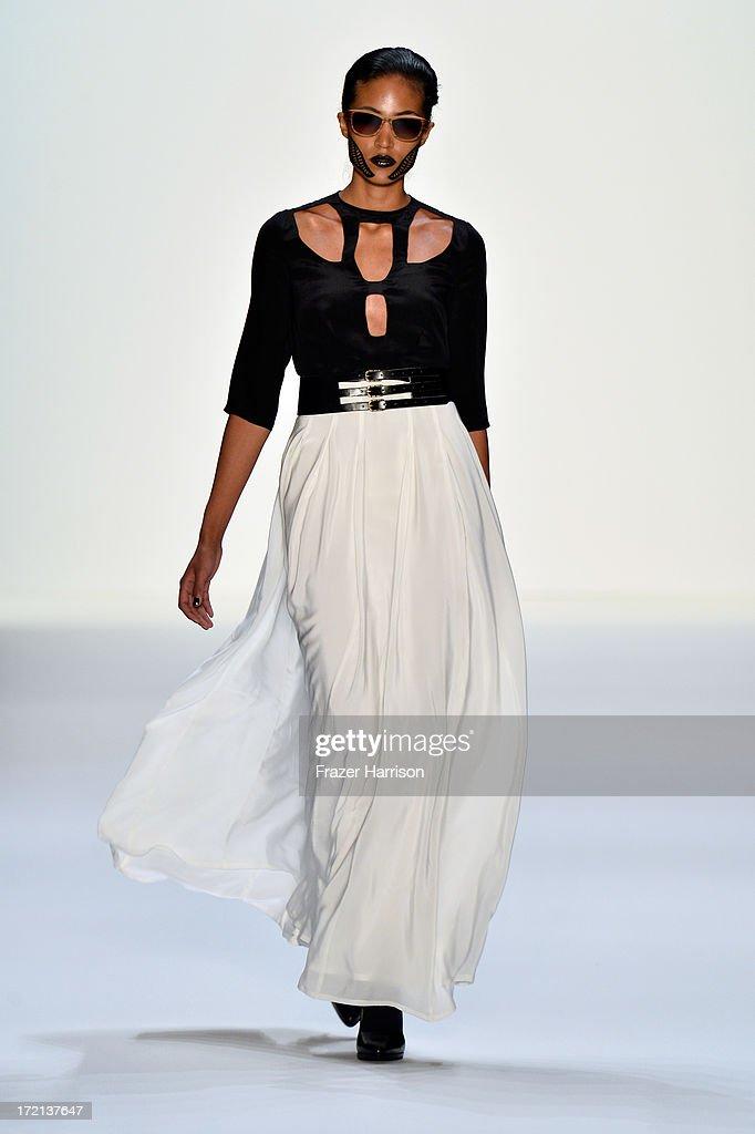 A model walks the runway at the Rebekka Ruetz show during Mercedes-Benz Fashion Week Spring/Summer 2014 at Brandenburg Gate on July 2, 2013 in Berlin, Germany.