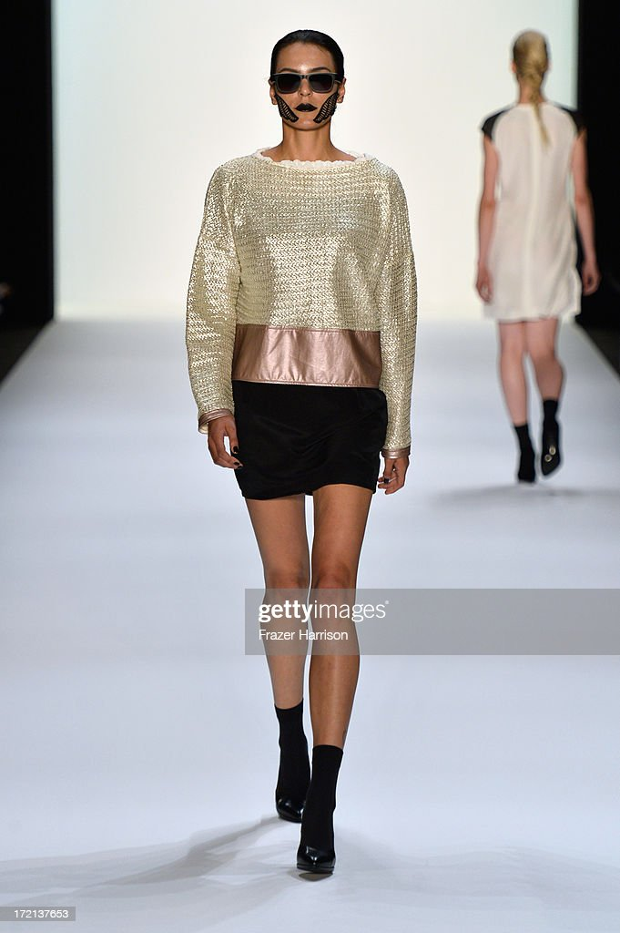A model walks the runway at the Rebekka Ruetz show during Mercedes-Benz Fashion Week Spring/Summer 2014 at Brandenburg Gate on July 2, 2013 in Berlin, Germany.