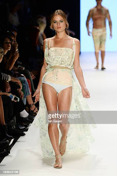 A model walks the runway at the Red Beard By Tanju Babacan show during MercedesBenz Fashion Week Istanbul s/s 2014 presented by American Express on...