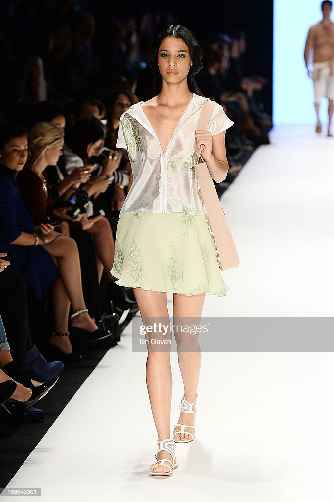 A model walks the runway at the Red Beard By Tanju Babacan show during Mercedes-Benz Fashion Week Istanbul s/s 2014 presented by American Express on October 8, 2013 in Istanbul, Turkey.