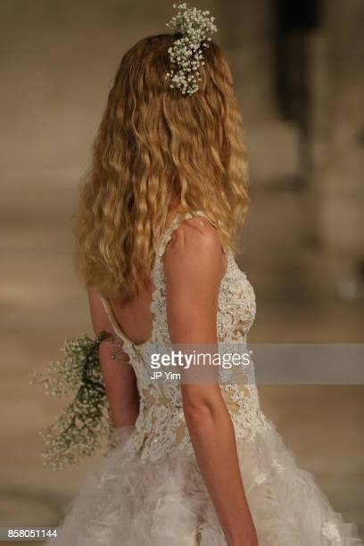 A model walks the runway at the Reem Acra FW 2018 Bridal Show at the New York Public Library on October 5 2017 in New York City