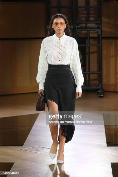 A model walks the runway at the REJINA PYO show during London Fashion Week September 2017 on September 19 2017 in London England