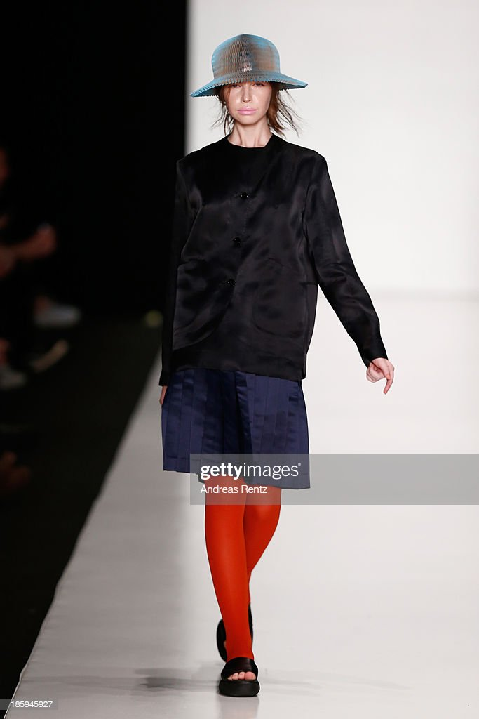 A model walks the runway at the RIA KEBURIA show during Mercedes-Benz Fashion Week Russia S/S 2014on October 26, 2013 in Moscow, Russia.