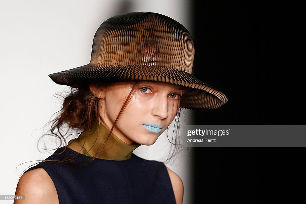 A model walks the runway (hat detail) at the RIA KEBURIA show during Mercedes-Benz Fashion Week Russia S/S 2014on October 26, 2013 in Moscow, Russia.