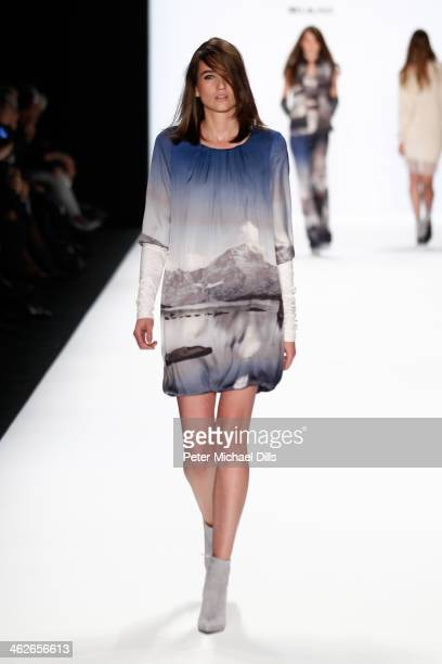 A model walks the runway at the Riani show during MercedesBenz Fashion Week Autumn/Winter 2014/15 at Brandenburg Gate on January 14 2014 in Berlin...