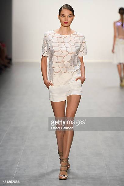 A model walks the runway at the Riani show during the MercedesBenz Fashion Week Spring/Summer 2015 at Erika Hess Eisstadion on July 8 2014 in Berlin...
