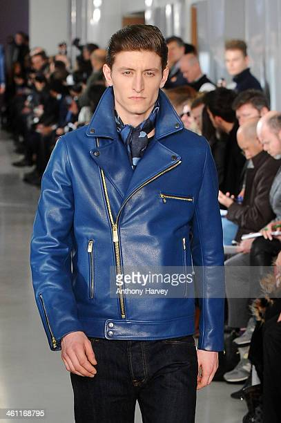 A model walks the runway at the Richard James show during The London Collections Men Autumn/Winter 2014 on January 7 2014 in London England