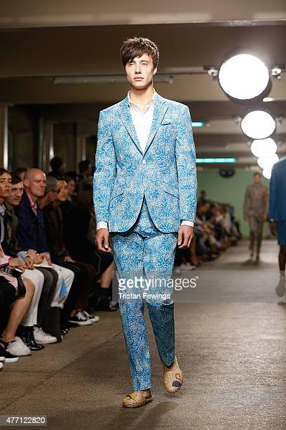 A model walks the runway at the Richard James show during The London Collections Men SS16 at the ICA car park on June 14 2015 in London England