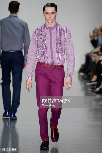 A model walks the runway at the Richard Nicoll Autumn Winter 2014 fashion show during London Menswear Fashion Week on January 6 2014 in London United...