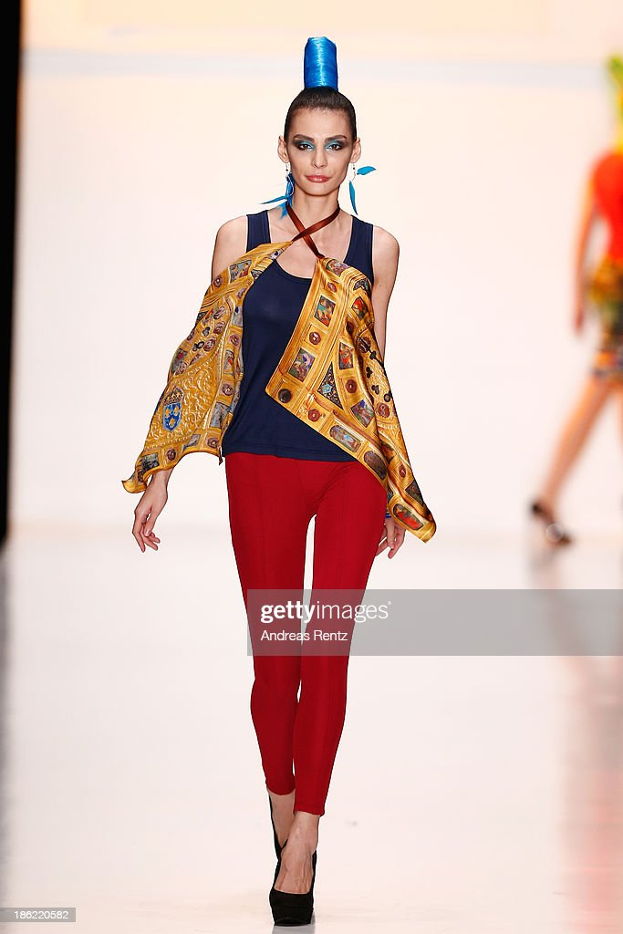 A model walks the runway at the ROB-ART by Katya Rozhdestvenskaya show during Mercedes-Benz Fashion Week Russia S/S 2014 on October 29, 2013 in Moscow, Russia.