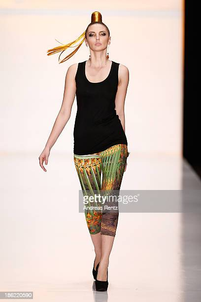 A model walks the runway at the ROBART by Katya Rozhdestvenskaya show during MercedesBenz Fashion Week Russia S/S 2014 on October 29 2013 in Moscow...