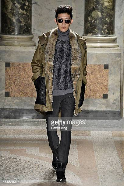 A model walks the runway at the Roberto Cavalli Autumn Winter 2015 fashion show during Milan Menswear Fashion Week on January 20 2015 in Milan Italy