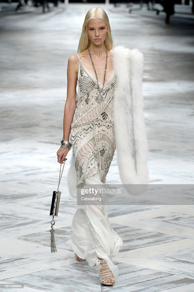 A model walks the runway at the Roberto Cavalli Spring Summer 2014 fashion show during Milan Fashion Week on September 21, 2013 in Milan, Italy.