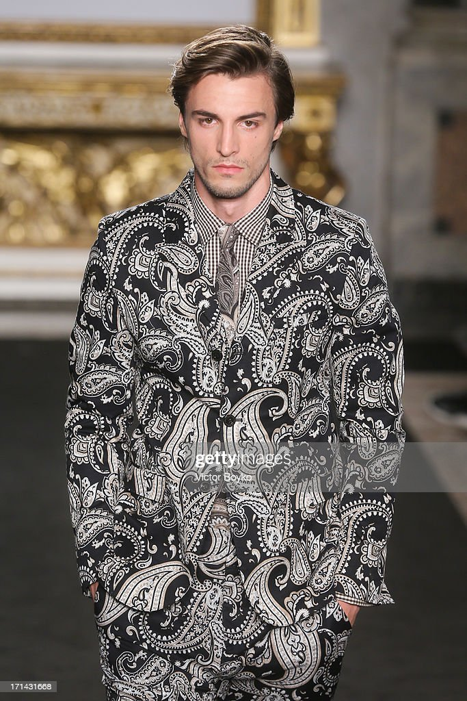 A model walks the runway at the Roccobarocco show during Milan Menswear Fashion Week Spring Summer 2014 show on June 24, 2013 in Milan, Italy. on June 24, 2013 in Milan, Italy.