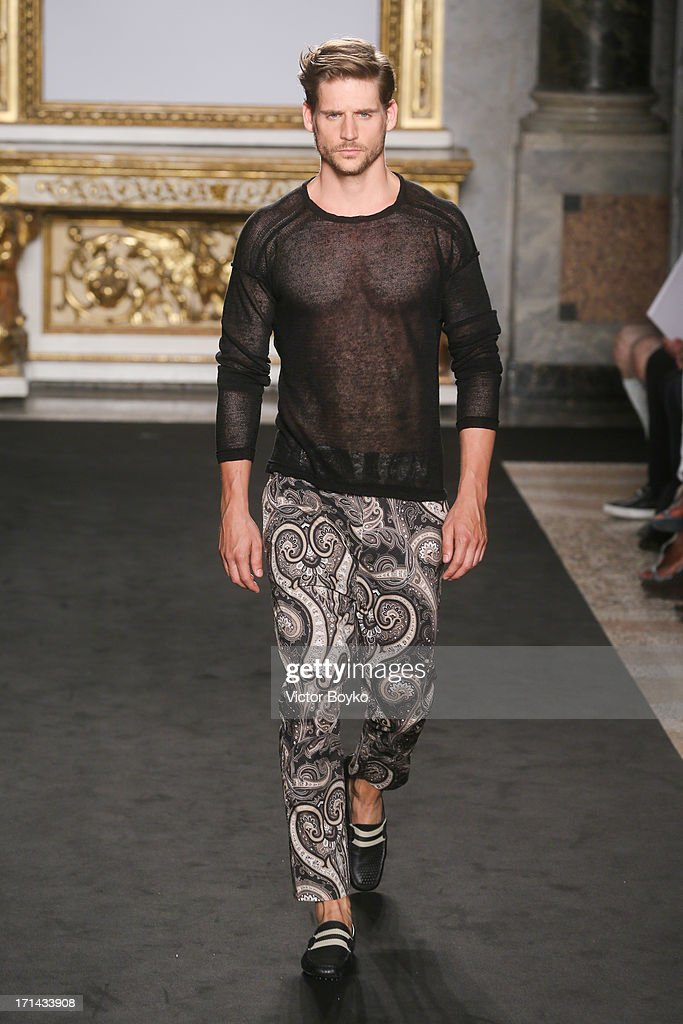 A model walks the runway at the Roccobarocco show during Milan Menswear Fashion Week Spring Summer 2014 show on June 24, 2013 in Milan, Italy.