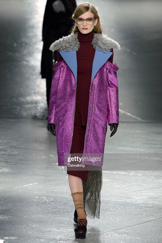 A model walks the runway at the Rodarte Autumn Winter 2014 fashion show during New York Fashion Week on February 11, 2014 in New York, United States.