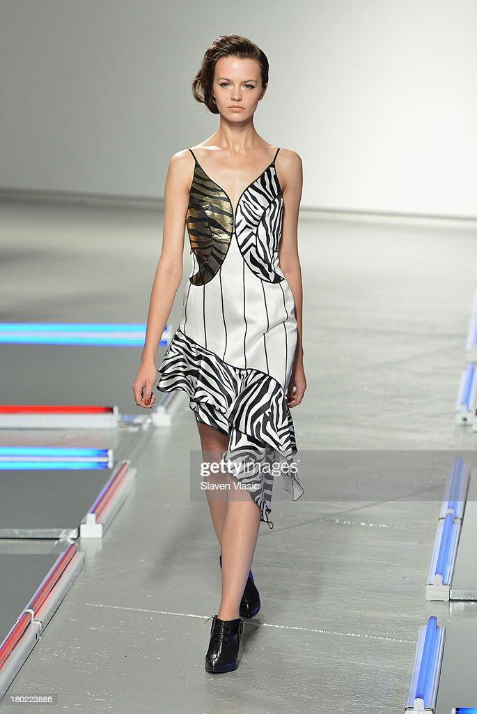 A model walks the runway at the Rodarte fashion show during Mercedes-Benz Fashion Week Spring 2014 on September 10, 2013 in New York City.