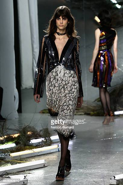 A model walks the runway at the Rodarte fashion show during MercedesBenz Fashion Week Fall 2015 at Center 548 on February 17 2015 in New York City