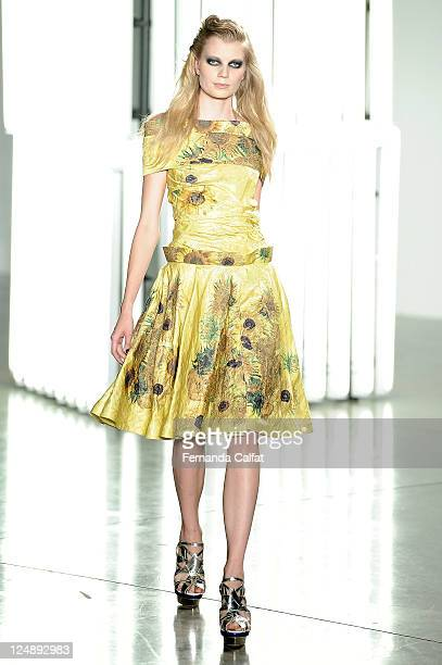 A model walks the runway at the Rodarte Spring 2012 fashion show during MercedesBenz Fashion Week at on September 13 2011 in New York City