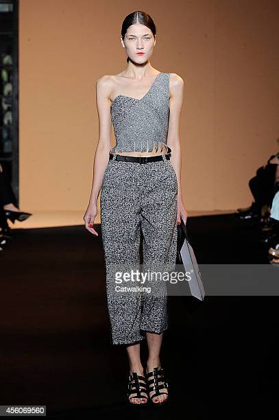 A model walks the runway at the Roland Mouret Spring Summer 2015 fashion show during Paris Fashion Week on September 25 2014 in Paris France