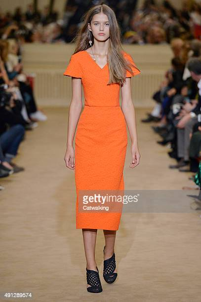 A model walks the runway at the Roland Mouret Spring Summer 2016 fashion show during Paris Fashion Week on October 4 2015 in Paris France