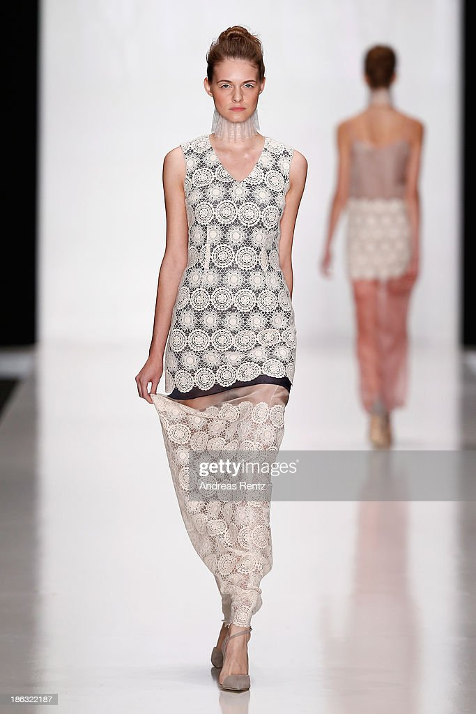 A model walks the runway at the RUBAN show during Mercedes-Benz Fashion Week Russia S/S 2014 on October 30, 2013 in Moscow, Russia.