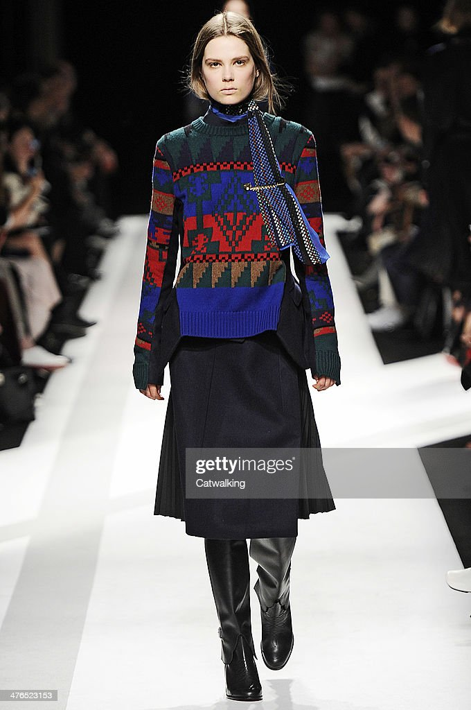 A model walks the runway at the Sacai Autumn Winter 2014 fashion show during Paris Fashion Week on March 3, 2014 in Paris, France.
