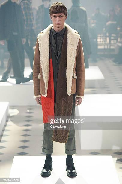 A model walks the runway at the Sacai Autumn Winter 2015 fashion show during Paris Menswear Fashion Week on January 24 2015 in Paris France