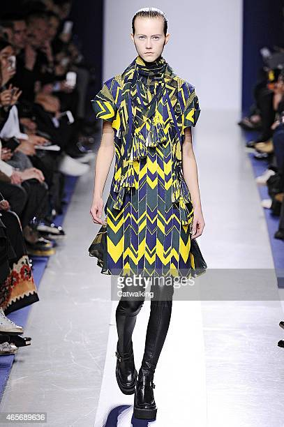 A model walks the runway at the Sacai Autumn Winter 2015 fashion show during Paris Fashion Week on March 9 2015 in Paris France