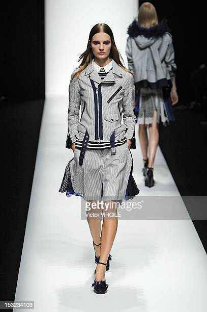 A model walks the runway at the Sacai Spring Summer 2013 fashion show during Paris Fashion Week on October 1 2012 in Paris France