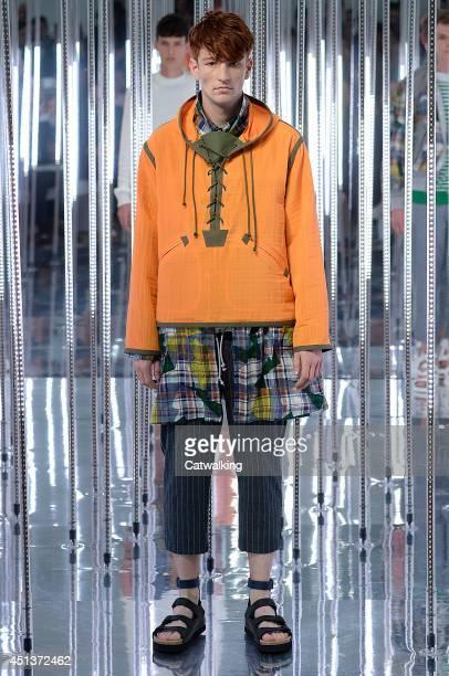A model walks the runway at the Sacai Spring Summer 2015 fashion show during Paris Menswear Fashion Week on June 28 2014 in Paris France