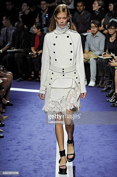 A model walks the runway at the Sacai Spring Summer 2015 fashion show during Paris Fashion Week on September 29 2014 in Paris France