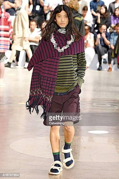 A model walks the runway at the Sacai Spring Summer 2016 fashion show during Paris Menswear Fashion Week on June 27 2015 in Paris France