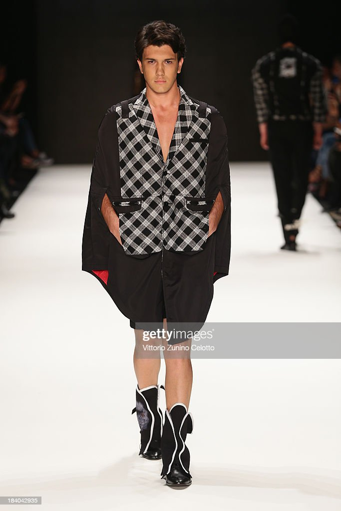 A model walks the runway at the Safak Tokur show during Mercedes-Benz Fashion Week Istanbul s/s 2014 Presented By American Express on October 11, 2013 in Istanbul, Turkey.