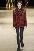 A model walks the runway at the Saint Laurent Autumn Winter 2014 fashion show during Paris Menswear Fashion Week on January 19 2014 in Paris France