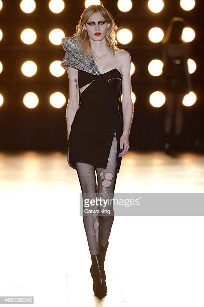 A model walks the runway at the Saint Laurent Autumn Winter 2015 fashion show during Paris Fashion Week on March 9 2015 in Paris France