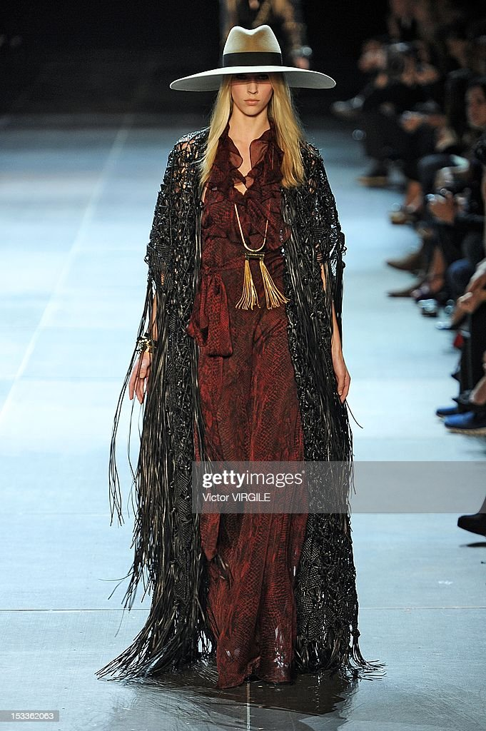 A model walks the runway at the Saint Laurent Spring Summer 2013 fashion show during Paris Fashion Week on October 1 2012 in Paris France